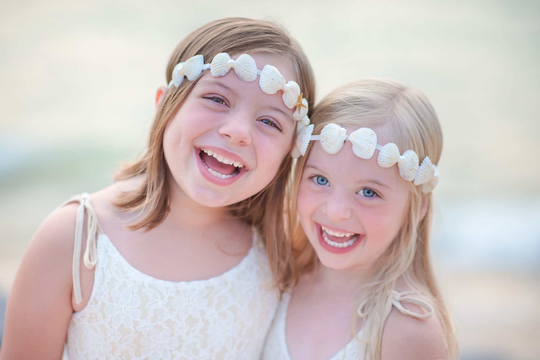 Close up of two girls laughing at a Lake Michigan beach
