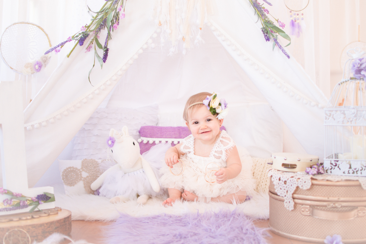first birthday session with girl in purple and white