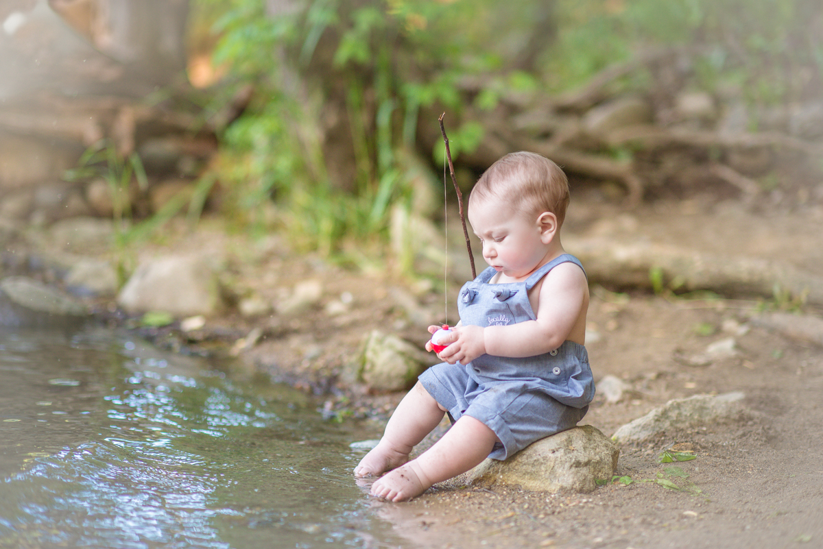 first birthday session of boy at river fishing