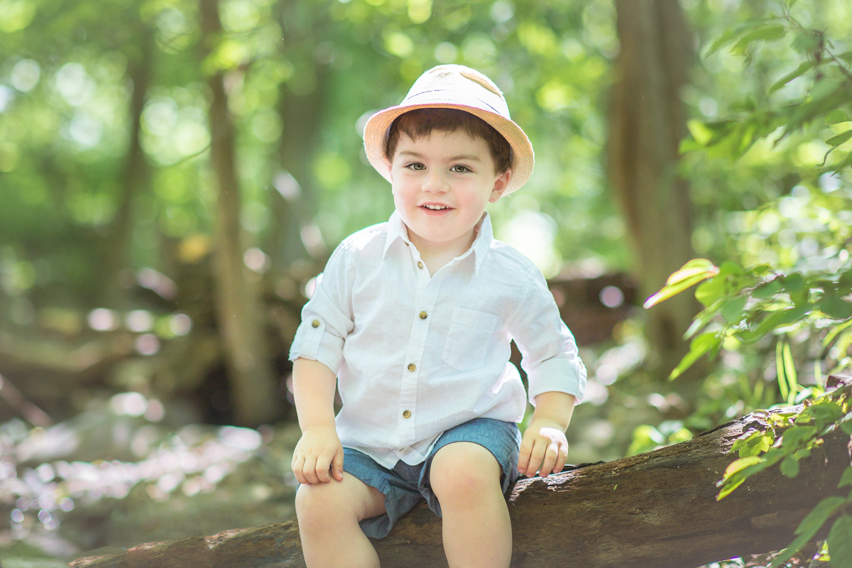 outdoor child session with a boy at the creek